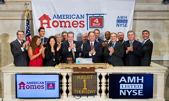 American Homes 4 Rent CEO David Singelyn and members of the company's leadership team at the company's IPO