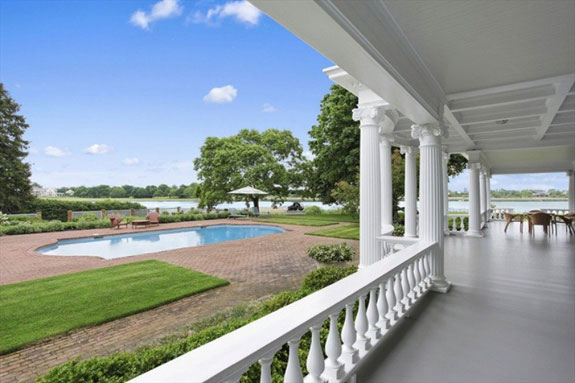 this-is-one-view-of-the-backyard-where-you-can-see-the-heated-pool-is-just-a-few-steps-from-the-bay