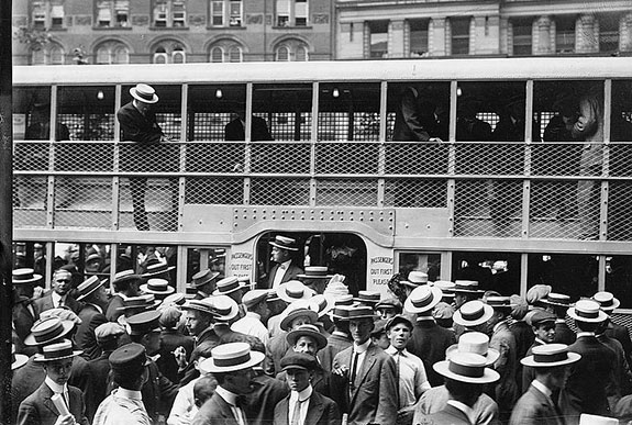 A crowded double-decker New York City streetcar circa 1910