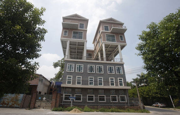 chinese-sky-high-dwellings-these-precarious-looking-houses-were-built-on-the-rooftop-of-a-factory-building-in-in-dongguan-china-the-houses-were-completed-two-years-ago-according-to-local-media-the-government-said-the