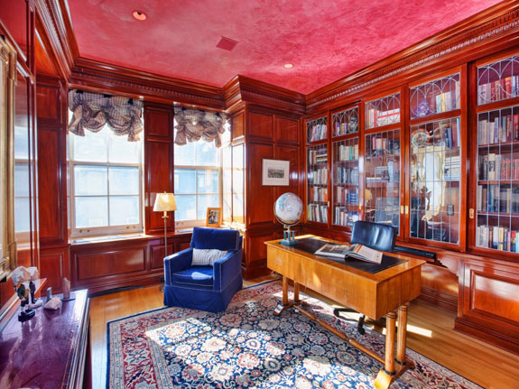 the-library-still-retains-the-classic-old-world-feel-with-custom-wood-cabinetry-and-a-venetian-plaster-ceiling-1