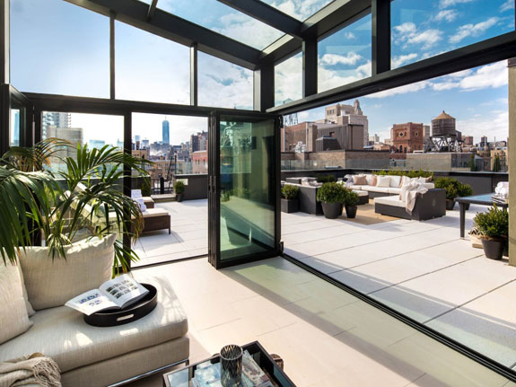 the-roof-deck-has-an-all-glass-three-season-room-that-can-be-opened-or-closed-based-on-the-time-of-the-year