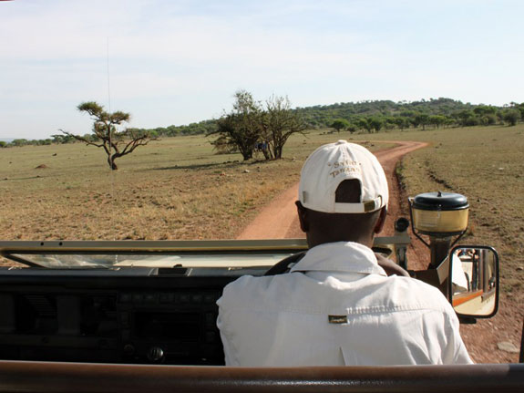 after-a-three-hour-drive-from-sasakwa-airstrip-through-the-plains-of-grumeti-reserve-we-finally-spotted-sabora-tented-camp-in-the-distance