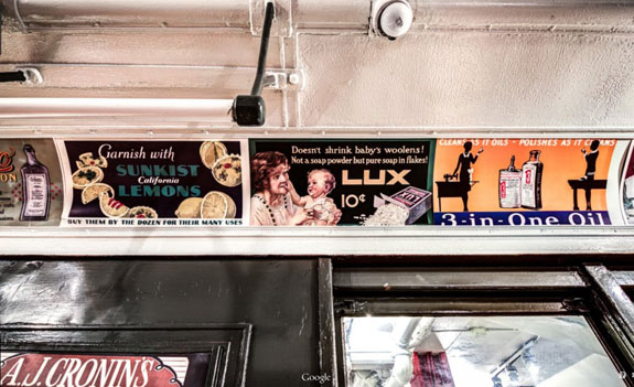 inside-the-subway-cars-are-collections-of-advertising-from-the-early-1900s