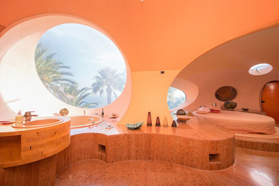 in-one-of-the-bathrooms-which-looks-more-like-a-spa-the-sink-and-bath-are-curved-you-wont-find-any-straight-lines-in-this-house