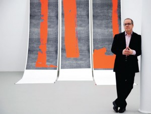 "Mana Contemporary founder and executive director, Eugene Lemay, stands with his artwork, ""Untitled, 2011."" Photo by Esther Montoro."