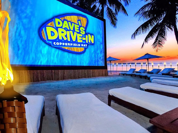 to-end-the-night-sprawl-out-on-a-comfy-lounge-chair-with-an-after-dinner-drink-and-a-movie-at-daves-drive-in