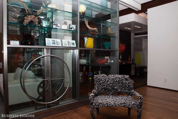 a-large-glass-wall-can-be-slid-across-the-floor-by-turning-this-wheel-doing-so-effectively-divides-the-space-into-separate-rooms