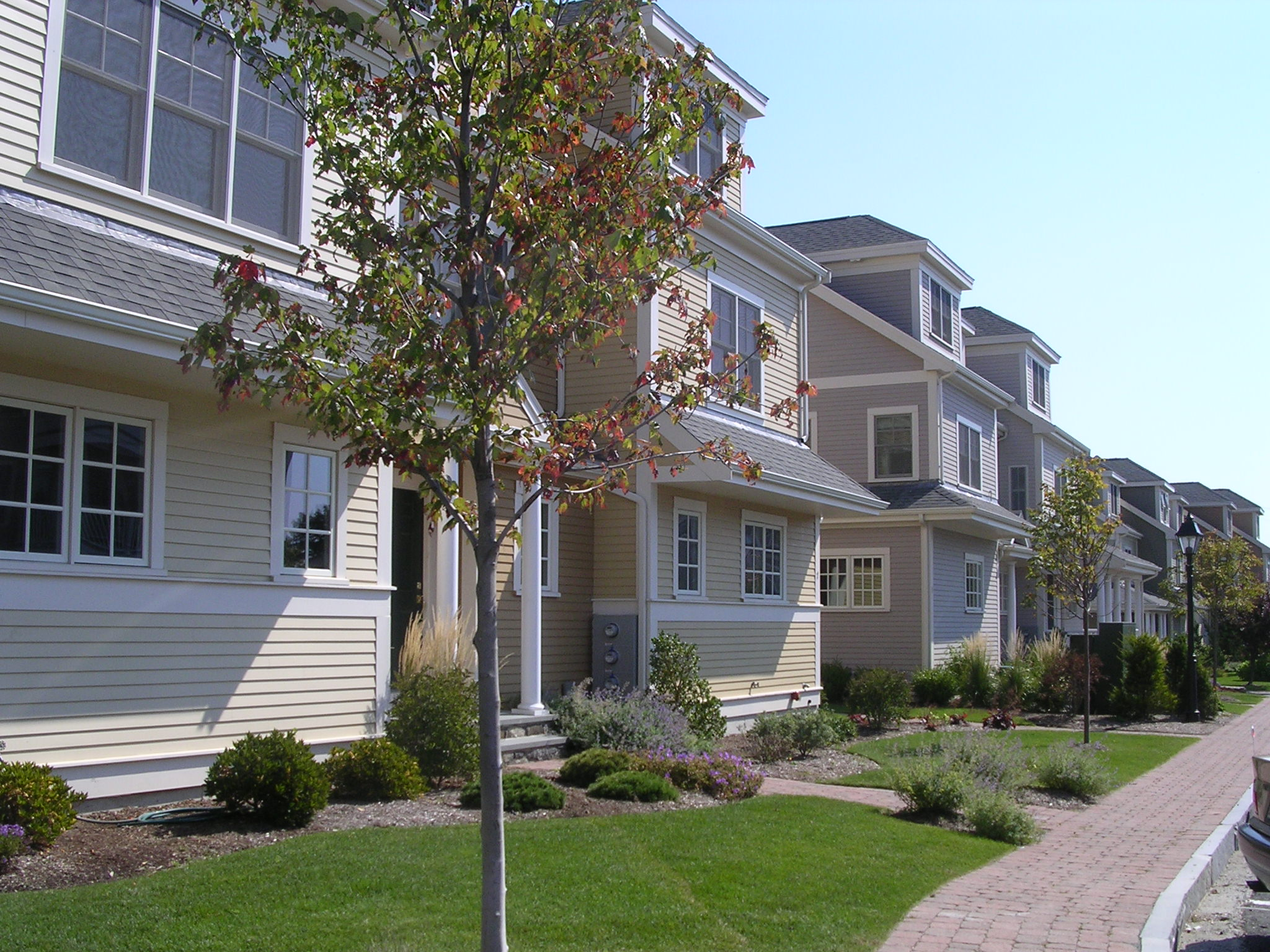 Us mcmansions national association home builders for Townhouse construction cost